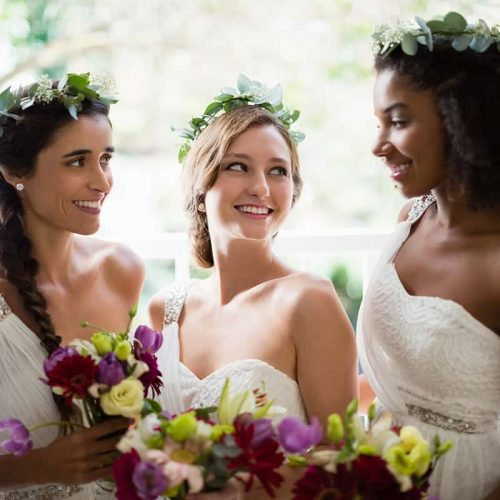 bride-and-bridesmaids-standing-with-bouquet-WUP98TF.jpg